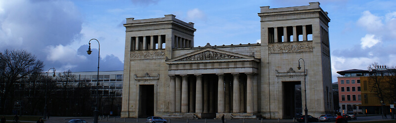 old building with columns and two towers
